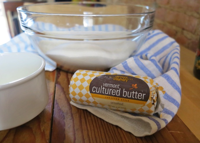 cultured butter = cream that has been set aside and exposed to cultures (much like crème fraîche) before being churned into butter.